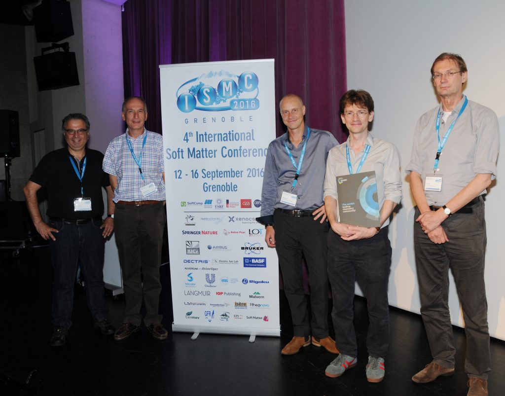 Soft Matter award given to Damien Baigl, U Paris, (second from right) during the ISMC2016. Copyright: Serge Claisse@ILL, www.ill.eu, reprinted by permission of Taylor & Francis LLC, from Fragneto G at al., Neutron News, 2016;28(1):11-14.