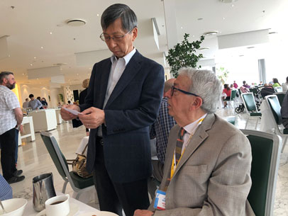 Profs Giuseppe Marrucci and Masao Doi discussing polymer physics at breakfast. Source: AERC2018 local committee